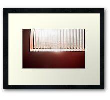 Sunlight streaming through the venetian blinds of an office window Framed Print