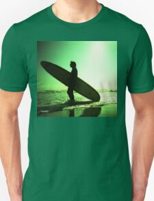 Surfer carrying surfboard in surreal silhouette in green in sea ocean water by beach 35mm analog xpro cross lomo lca photo Unisex T-Shirt