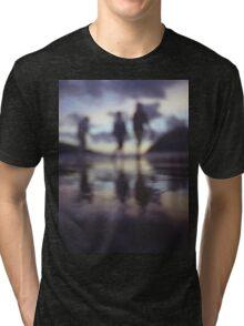 Silhouette of people walking on beach dusk sunset evening sky Hasselblad medium format film analogue photo Tri-blend T-Shirt