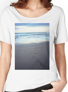 Foot prints at dawn on empty sandy beach sea side Hasselblad square medium format film analogue photograph Women's Relaxed Fit T-Shirt