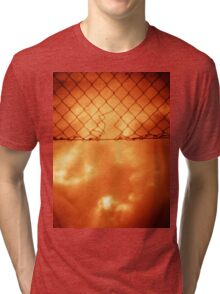Wire mesh fence against stormy sky silver gelatin black and white medium format 120 6x6 negative analog film photo in sepia tones Tri-blend T-Shirt