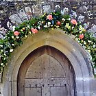 Roses around the Church at  St Just in Roseland Cornwall UK by lynn carter