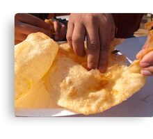 Eating by hand the Indian delicacy of Chole Bhature Canvas Print