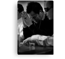 Poncho Thinking over Poker Hand Canvas Print