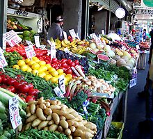 Vegetable and fruit stand at the Pike Place Market in Seattle, Washington by DonnaMoore