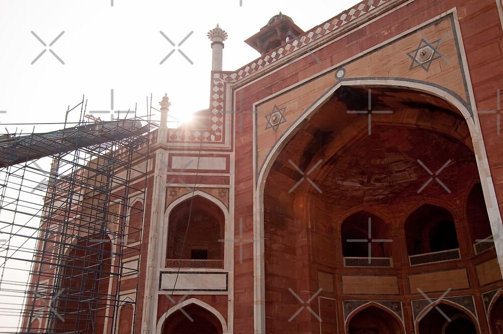 Sun peeking over the edge of the Humayun Tomb undergoing renovation by ashishagarwal74