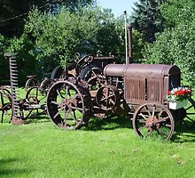 Old Tractor with mower and flowers by May Lattanzio