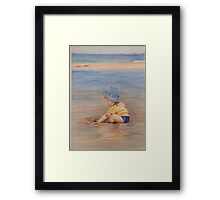 Digging in the Sand Framed Print