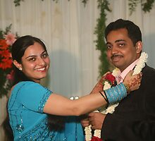 The Bride puts varmala on the Groom by AnIndianWedding