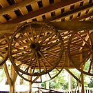 old stagecoach wheels by Sheila McCrea