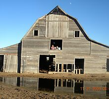 Kids with the moon over the barn in the daytime by BobbyJo72