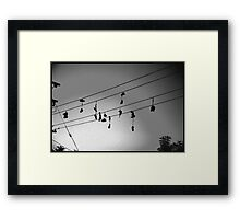 shoes in the sky Framed Print