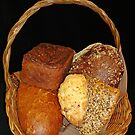 Basket full of bread by Paola Svensson