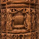 A stone pillar with beautiful carvings inside the Qutub Minar complex by ashishagarwal74