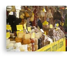 Cheeses, salami, sausages display Canvas Print
