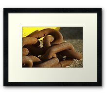chained down Framed Print