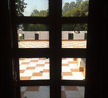 A meshed door opening to an open courtyard by ashishagarwal74