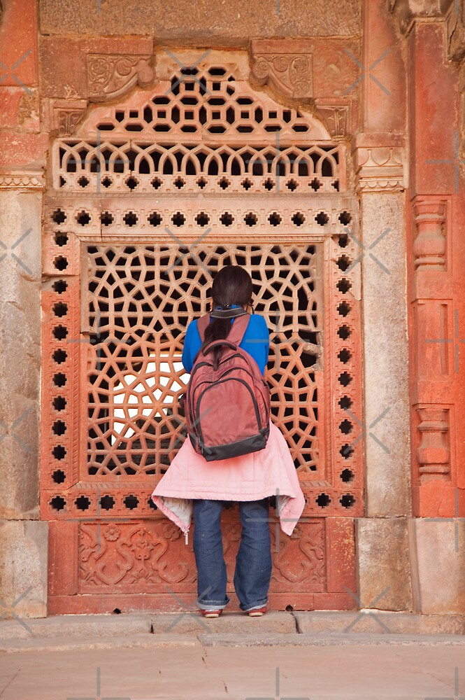 Girl peering into the latticed wall at Humayun Tomb by ashishagarwal74