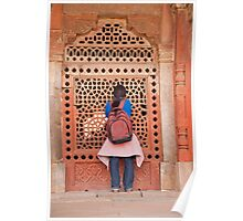 Girl peering into the latticed wall at Humayun Tomb Poster
