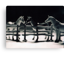 Toy Horses in a stable. Canvas Print