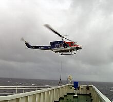 Bell 212 hovering off the bridge wing of a laden supertanker by Alasdair
