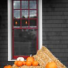 Pumpkins and Hay on a Porch by Wayne King