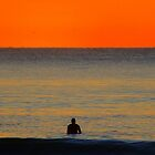 Waiting for the Sun, a lone surfer  by Of Land & Ocean - Samantha Goode