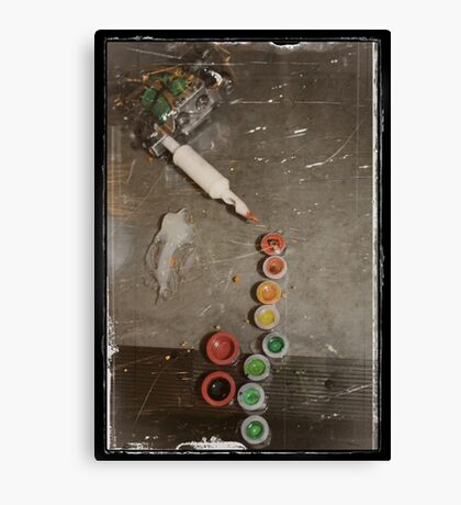layed on the glass.....guns kill.....machines create Canvas Print