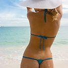 Blonde in white hat on the beach by Dmitry Rostovtsev