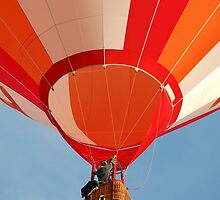 Orange and White Striped Hot Air Balloon in Flight Over Blue Sky by HotHibiscus
