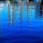 Masts reflected in the harbour in Barcelona. by John McGuigan