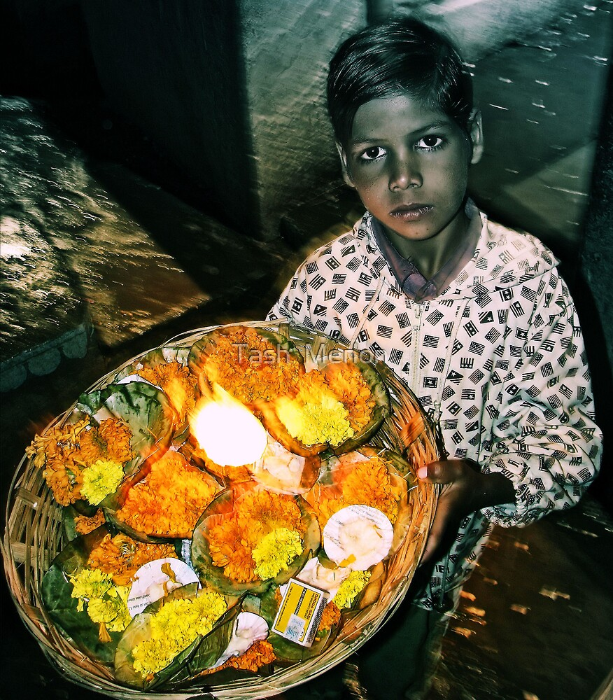 """""""Never deprive someone of hope; it might be all they have."""" , A young boy selling flowers via the Ganges, Varanasi, India 2008 by Tash  Menon"""