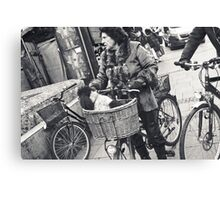 dog getting a bicycle ride Canvas Print