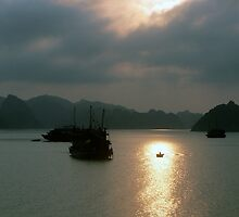 Halong Bay fishing boat at sunset, Vietnam by John Mitchell