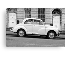 Morris Minor 1000 vintage British motor car parked on a hill in Bath England  Canvas Print