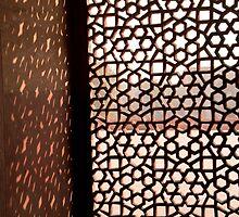 Light coming through the stone lattice at Humayun Tomb by ashishagarwal74