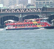 Tourist Ferry Passing the Erie Lackawanna Train and Ferry Terminal, Hoboken, New Jersey      by lenspiro