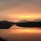 Dawn over Loch Laggan. by John Cameron