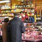 At the delicatessen stall, Perugia's covered market, Umbria, Italy by Philip Mitchell
