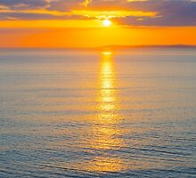 beautiful panoramic yellow sunset over loop head by morrbyte
