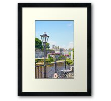 antique street lamp and cafe view of kilkenny castle Framed Print