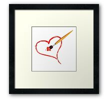 Brush painting a heart Framed Print
