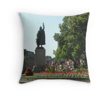 King Afred's statue & the High Street in summer, Winchester, southern England Throw Pillow