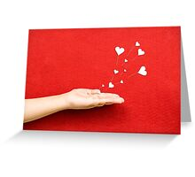 Blowing Hearts from a Hand Greeting Card