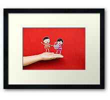 boy and girl with cupcake on a hand Framed Print
