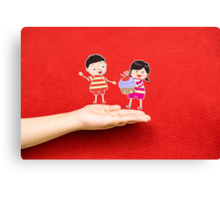 boy and girl with cupcake on a hand Canvas Print