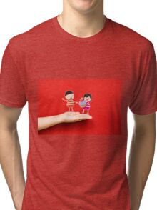 boy and girl with cupcake on a hand Tri-blend T-Shirt