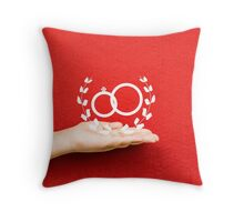 pair of wedding rings on a hand Throw Pillow