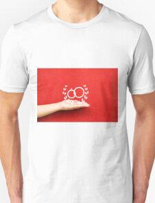 pair of wedding rings on a hand Unisex T-Shirt