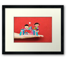 kids studying book on a hand Framed Print